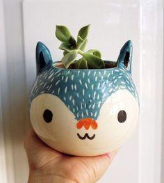 vaso de planta em formato de cabeça de gato