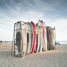Surfboards locked up for rentals or to use for surf lessons at the tourist travel destination surfing spot along Waikiki Beach, Honolulu Hawaii. Waikiki Beach, Honolulu Hawaii, Surfing Tips, Surfboards, Travel Destinations, Outdoor Decor, Instagram Posts, Surfs, Destinations