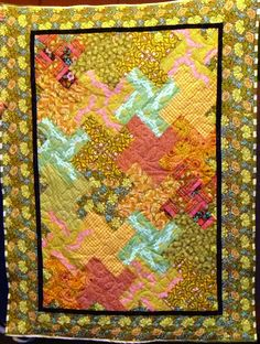 Playful whirligigs make a pretty quilt.