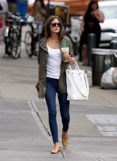 Take a cue from the stylish Olivia Palermo and rock this classic weekend outfit: cargo jacket, white tank, skinny jeans, nude flats, and white handbag. (Iced coffee also makes a great accessory!)