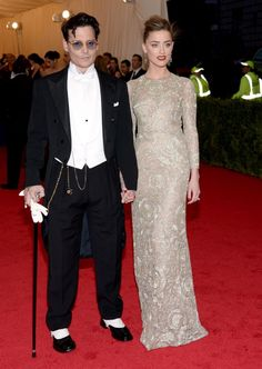 Johnny Depp and Amber Heard held hands as they walked the red carpet at the Met Gala on May 5, 2013. Johnny Depp wore a classic Ralph Lauren tuxedo, tails and cane included, while his fiancee donned a striking Giambattista Valli gown.