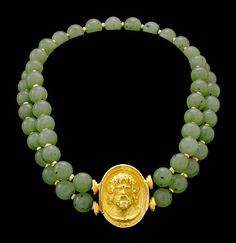 Fine double strand jade bead choker with handmade clasp of Zeus, in 18K yellow gold. Jade beads segmented by 18K roundels. Length 14 3/4 inc...