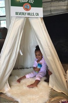 This is so fun: North West played in the teepees at Kim Kardashian's baby shower in Beverly Hills on Sunday