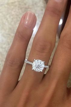 24 Top Round Engagement Rings ❤️ See more: http://www.weddingforward.com/round-engagement-rings/?utm_content=buffer513bb&utm_medium=social&utm_source=pinterest.com&utm_campaign=buffer #wedding #weddingrings #ringswedding #ringwedding