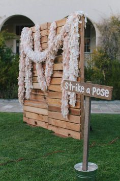 """I want to make a Photo Booth like this. Would be cheap and easy to make with pallet boards. Would give the guests something to do and would result in cute/funny pictures. Will buy random props to add to it (chalkboard, team bride, team groom signs, hats, boas, etc.) If this is not doable, I also like the idea of just hanging a giant frame from the trees as the """"photo booth"""""""