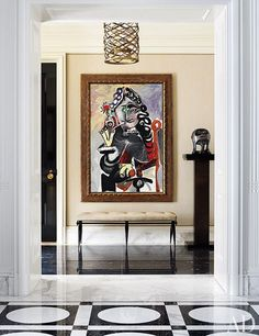 Michael S. Smith used elegant period antiques to provide contrast to the museum-quality art in this Manhattan apartment. The entry hall features a Picasso painting and a sculpture by Henry Moore.