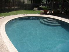 Light grey pool plaster Pool Plaster Colors, Backyard, Patio, Pool Water, Pool Houses, Pavilion, Swimming Pools, Outdoor Decor, Outdoor Ideas