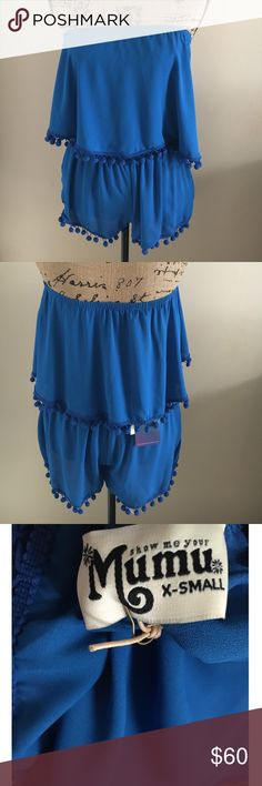 Show Me Your Mumu Banjo Pom Pom top Scrunched just right her cut gives everyone a flattering bust line without being super tight and constricting. Her pom pom trim bounces with every step and twirl. Pair her with Sammy Pom Pom Shorts only if you want to seriously own the night.    *MADE IN THE GORGE USA*   *100% Poly   *Lined in front  ✨Please note that the top and shorts are sold separately✨ Show Me Your MuMu Tops Crop Tops