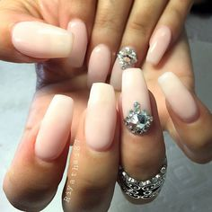 nude nails with a bit of bling on accent nail.