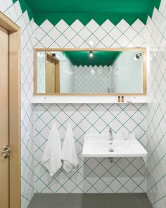 When designing the boutique in Metzingen, Germany, Krampulz Meyer Architekten incorporated emerald touches meant to evoke the nearby forests, as seen in the guest bathroom's ceramic tile. 📸 by Roland Halbe. Interior Desing, Interior Design Magazine, Bathroom Interior Design, Large White Tiles, Coloured Grout, Bedroom Wall Designs, Bathroom Designs, Tile Covers, Upstairs Bathrooms