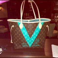 Louis Vuitton neverfull mm limited edition Aqua V Louis Vuitton limited edition turquoise V tote neverfull mm. Worn once. Practically brand new. This is for the bag only! Comes with dust bag and box and tags! Louis Vuitton Bags Totes