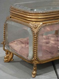 Spectacular Antique French Ormolu Bronze Beveled Glass Jewelry Box from XIXth C. It is a Rare Casket with Thick Lustrous Beveled Glass Panels without scratches or chips. The Interior is a Lovely Pink Silk Capitoné.The Ormolu is Very Majestic and in E Watching fine art and antiques auctions ending online.  CLICK ON PHOTO TO PREVIEW :-)