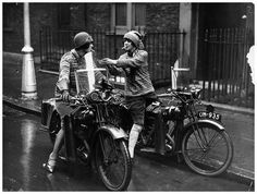 The Debenham sisters light up while out motorcycling. Nancy and Betty Debenham were poster girls for BSA motorcycles in 1926 They were hardy, tough, brave, knowledgeable and resilient motorcyclists Nancy won a Gold Medal at Brooklands Racetrack in 1926  (Photo by H F Davis/Getty Images)