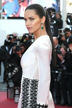 Adriana Lima chose a high-gloss ponytail in Cannes.