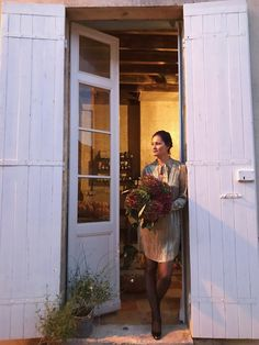 Mimi standing in a gorgeous doorway. Wish I lived in Medoc!
