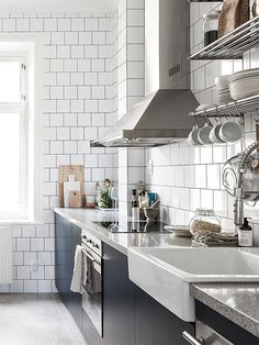 Scandinavian kitchen. white tiles, black grout.