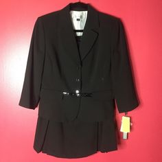 Tahari Levine Black Skirt Suit Set With Waist Belt Brand new Tahari Skirt Suit Set. Perfect office outfit or any occasion. Has a waist belt for the blazer. Skirt has two cute little open pleats in the front. Please feel free to leave comments  but no trades!  Tahari Skirts Skirt Sets