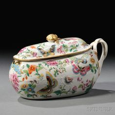 Chinese Export Porcelain Covered Chamber Pot, late 18th/early 19th century, shaped vessel with a gilt fruit-form knop on the domed cover, and reeded lapped strap handles, with allover polychrome enamel painted flowers, butterflies, birds, and insects, ht. 5 5/8, wd. 4 3/4, lg. 10 in.