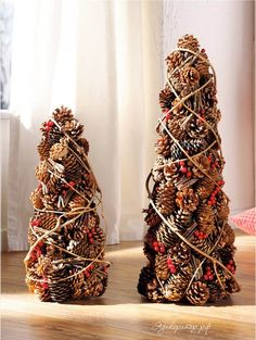 I'd spray paint the pine cones a solid color or maybe a few different shaded of the same color then wrap with a ribbon and glue on some mini ornaments (PRE-Christmas gifts perhaps)