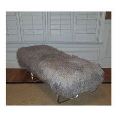 Lucite Bench With Mongolian Lamb Fur ($1,500) ❤ liked on Polyvore featuring home, furniture, benches, black, home & living, mongolian lamb bench, plexiglass furniture, ebony furniture, black furniture and slab furniture