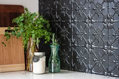 """Rachel and Marty's modern-classic Victorian cottage renovation:""""I love bits of black to pop,"""" Rachel says, """"like the kitchen splashback, which is pressed metal painted in matt black."""""""