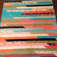 """Quilt My talented Mom made using """"Sassy"""" jelly roll by Moda. Way to go Mom!"""