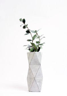 Designer objects: concrete vase, plant, home décor and accessories, industrial design, interior.