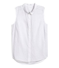 Light gray/striped. Sleeveless blouse in lightweight, woven cotton fabric with a collar. Buttons at front, yoke at back, and rounded hem. Longer at back.