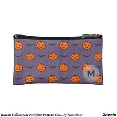 Kawaii Halloween Pumpkin Pattern Makeup Bag by NamiBear on Zazzle.com. This is a pattern of a smiling carved pumpkin with bats. The color of orange, purple, and black  adds to the feeling of fall and Halloween. The background has a texture that gives a bit of a grunge look. Your initial can be printed on this design.