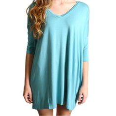 Paloma Blue Piko V-Neck Half Sleeve Tunic Dress SM Top is BRAND NEW! But may not come with tags. CONTENT & CARE 95% Bamboo 5% Spandex Machine wash cold with like colors Do not bleach  Do not use fabric softener  Hang to dry DETAILS & FIT Model is wearing size medium. Unlined Piko Tops Tunics