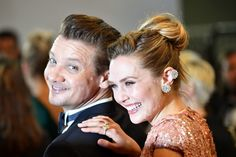 Jeremy Renner Photos Photos - US actor Jeremy Renner and US actress Elizabeth Olsen pose as they arrive on May 20, 2017 for the screening of the film 'Wind River' at the 70th edition of the Cannes Film Festival in Cannes, southern France.  / AFP PHOTO / Alberto PIZZOLI - 'Wind River' Red Carpet Arrivals - The 70th Annual Cannes Film Festival