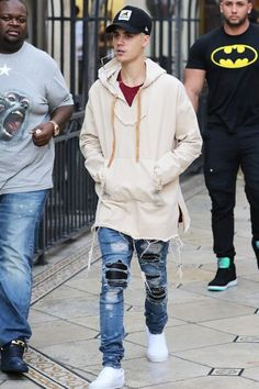 Justin Bieber wearing  Vans Classic Slip-On Shoes, Ray-Ban RB3447 Round Metal 001 Gold Sunglasses, New Era XXlarge Patch D-frame Trucker Cap, Amiri Leather Inset Distressed Jeans