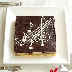 DIY Opera Cake- Love this simple musical theme. To create: Draw music notes & designs on a piece of paper. Cover drawings with (transparent) waxed paper. Pipe melted white chocolate onto waxed paper following the outlines of the notes and designs. Chill about 30 minutes or until set. Carefully lift notes and designs off waxed paper and arrange on top of cake.