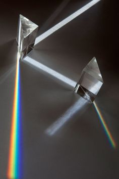 You've Never Seen Science Experiments Look Quite Like This | Light refracts and disperses through prisms in a white box, showing the visible color spectrum (red, orange, yellow, green, blue, violet). The separate of white light into these colors, called dispersion, happens when light waves pass through a transparent optical element, like this prism. | Credit: Laura Skinner | From Wired.com