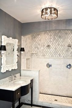 I love this white and gray bathroom!  I can't decide what I like more - the mirror? The light fixture?  The tile?