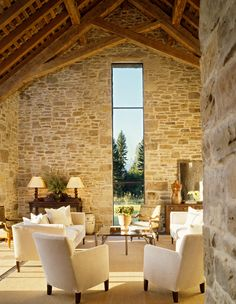 """Big Sky Journal - Exposed timbers and parged stone walls nearly outdo the view of The """"Grand"""" which is oriented in the center of the window. Reconstructed from the late 1800's, the window proportions were enhanced slightly but are derived from the original creamery design. Photo: Matthew Millman Photography"""