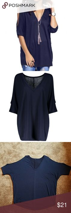 Low cut v neck asymmetrical  cold shoulder  top Deep blue , elbow length sleeves, very roomy, bust is about 26 inches across and length is approx 30 inches shoulder to rounded hem Tops