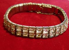 Mid Century crystal rhinestone bracelet 2 rows of square glass stones Perfect for wedding bridal jewelry Silver tone setting, with safety chain 7 x 3/8 inches Unsigned Very good vintage condition, shows no wear to the finish I specialize in vintage rhinestone jewelry, please visit my shop for more selections International buyers welcome, overcharges are refunded Flat rate Priority shipping is optional 101816  Want to see more great bracelets? Click here: https://www.etsy.com&#x...
