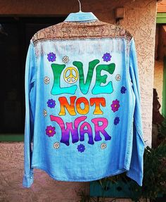 "Hand painted ""Love Not War"" peace and flowers denim shirt with boho fabric and fringe by @bleudoor on Instagram"