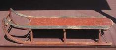 19th C Paint Decorated Sled with Provenance Red board with blue-green side rails and yellow pin striping along runners, knees, and side boards. Provenance on the sled dating back to 1877 in Somerville, NJ to a N. C. Porter. It was then handed down to Chester A Porter dated December 23 '98'.