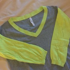 """Aeropostale Gray/Yellowgreen 1/2 Sleeve Sweater Cute v-neck sweater with fluorescent yellow/green trim and sleeves. Sleeves are 1/2 sleeves. Front comes up higher than back. Measures about 21"""" from top of shoulder to front bottom, 23"""" to back bottom. Worn once. 55% Cotton, 17% Polyester, 15% Rayon, 13% Acrylic. Aeropostale Sweaters V-Necks"""