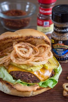 Meat rub goes rogue with this amped up grilled cheeseburger, rubbed with a savory blend of Smoky Montreal Steak Seasoning, chili powder and brown sugar. Up the flavor factor further with creative burger toppings: melty cheddar, BBQ mayo, grilled pickle slices and crispy onion straws. This burger recipe really is as bold and fun as it looks!