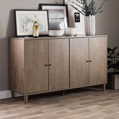 Add a stylish look to any space with this light charcoal grey Vilas buffet. Adjustable shelving and a rubberwood construction finish this buffet.