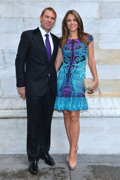 Elizabeth Hurley in #RobertoCavalli with Shane Warne at the Spring Summer 2013 Fashion Show in Milan