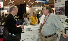 AAEP 2010 - ESS Booth, conversation with a customer/show attendee