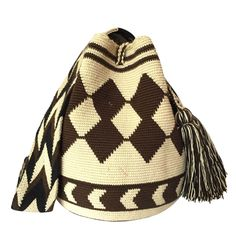 These double thread Wayuu mochila bags are all made in the region of La Guajira, Colombia by indigenous Wayuu women. Mochila bags are a very important handicraft that helps sustain the indigenous Wayuu people. These bags take approximately 10 days to make. The craft of crocheting is learnt at an early age and passed down from generation to generation. The mochilas are a reflection of the everyday shapes that surround the lives of the Wayuu tribe. Buy yours atwww.lombiaandco.com Tapestry Bag, Tapestry Crochet, Mochila Crochet, Tribal Patterns, Jute Bags, Handmade Handbags, Poufs, Filet Crochet, 10 Days