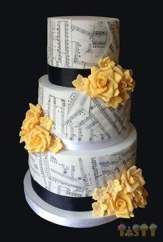 How do you put the paper on the cake? Thinking of a piano keyboard on the bottom and music on top. Love this cake!