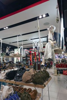 In store visual merchandising platforms constructed from birch plywood and suspended from the ceiling on white webbing Topshop Oxford St