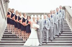 Navy bridesmaids. Gray suits with navy ties. coral and white bouquets and bouts. maybe wrap a coral chevron ribbon arounds brides bouquet.