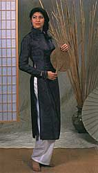 #139 Vietnamese Ao Dai Misses Extra Small to Extra Large. $19.95  This feminine ensemble of flowing Tunic and wide-legged pants is considered the traditional costume of Vietnam. The easy-sew Tunic features front and back waist shaping darts, mandarin collar, front neckline/armhole opening, tapered long sleeves with elbow darts, and long free-hanging front and back panels. The Pants have an easy full-legged fit, center back zipper, and faced waistline.